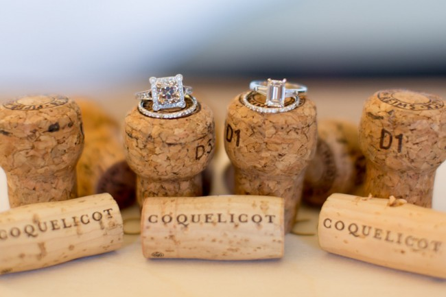 engagement-rings-wedding-bands-atop-champagne-corks_full